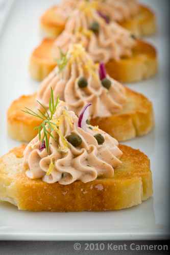 salmon dip piped onto crostini