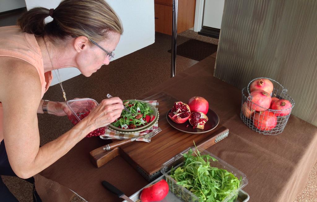 food styling setup shot with pomegranates