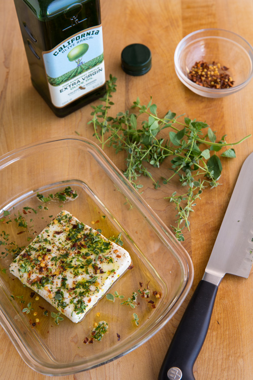 goat feta cheese with herbs and olive oil