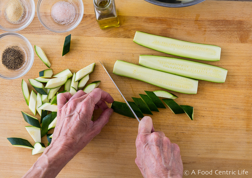 chopping zucchini for grilling | AFoodCentricLife.com