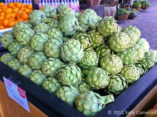 Artichokes at the store|AFoodCentricLife.com