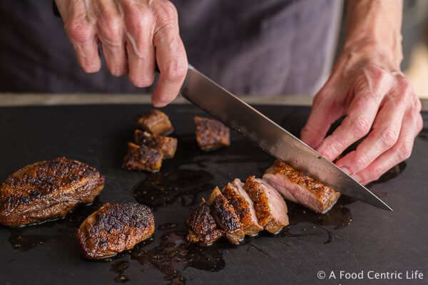 Slicing crispy seared duck breast|AFoodCentricLife.com